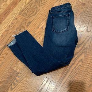 Stair step hem distressed jeans
